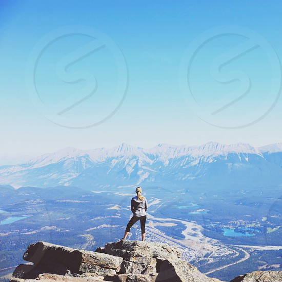 woman standing on top of rocks photo