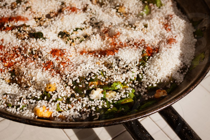 paella spanish spain rice spinach cauliflower cooking cook prep simmer simmering  photo