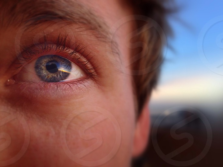 Thought it'd be interesting  to take a closeup selfie of my eye. Had no idea how much of the sunset my eye was capable of reflecting! Bernal Hill in San Francisco CA photo