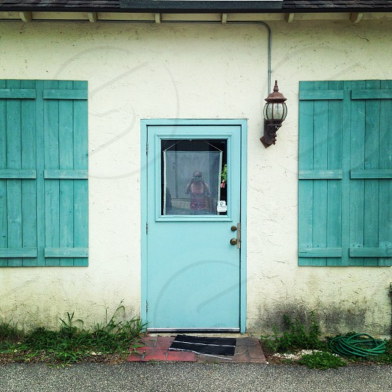 Vintage old building with shutters and a blue door photo