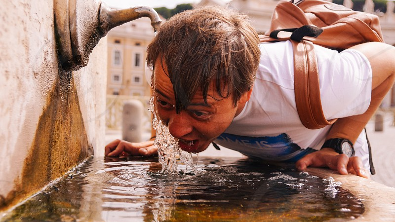 Water fountain hot weather summer drinking man street thurst photo