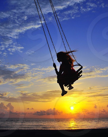 woman riding on a swing photo