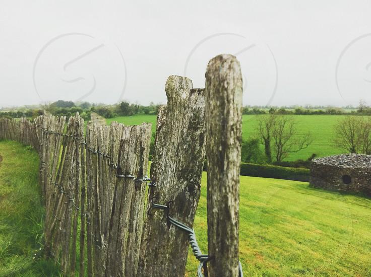 Ireland Irish Irish fence old fence Irish countryside fence wooden fence fence posts country countryside green grass photo