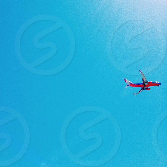 blue and red white plane photo