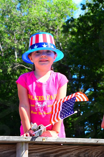 Adorable girl in Fourth of July parade photo