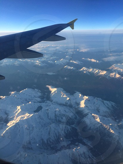 View from airplane window over the Alps photo
