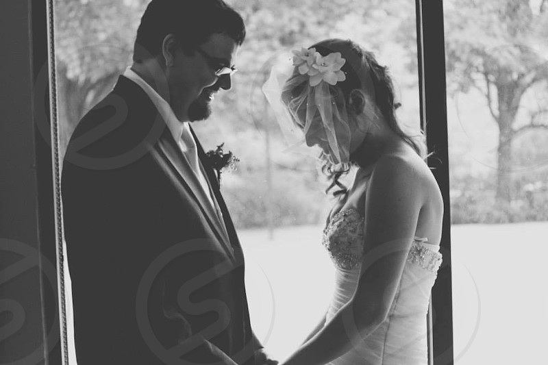 bride and groom holding hands smiling photo