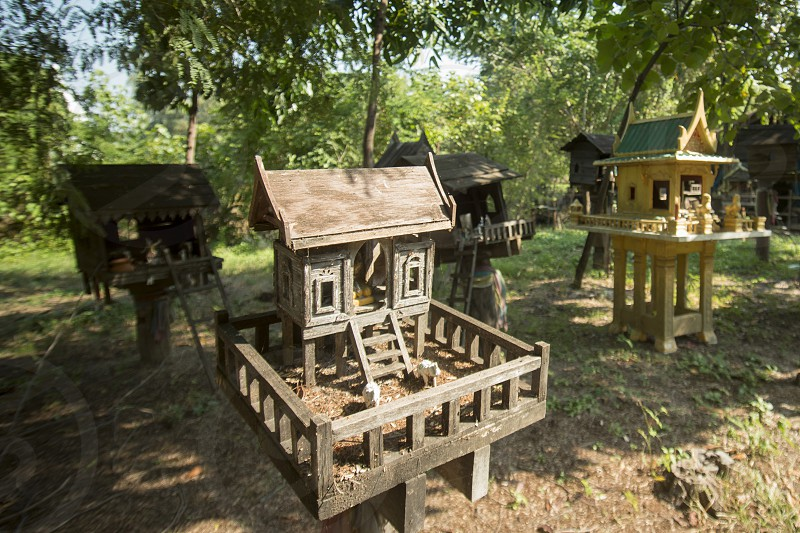traditional spirit houses in Isan in east Thailand in Southeastasia.   photo