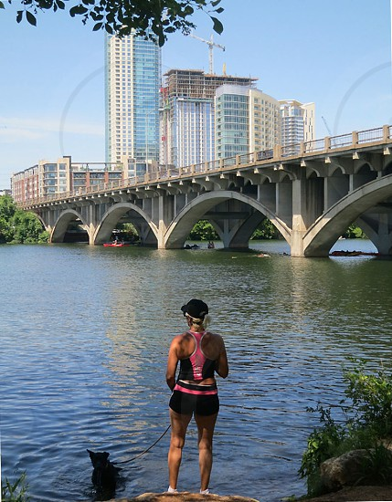 Austin Texas skyline and Lamar Blvd Bridge over Ladybird Lake from vantage point of Hike and Bike Trail. photo
