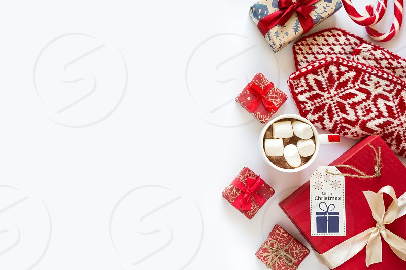 Christmas background with handmade presents wrapped in craft paper cup of hot chocolate and tablet. Flat lay. Space for copy photo
