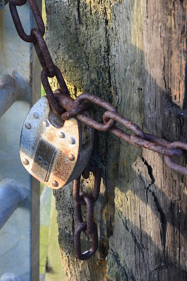 Old Vintage locker with metal chains wooden backgroung photo