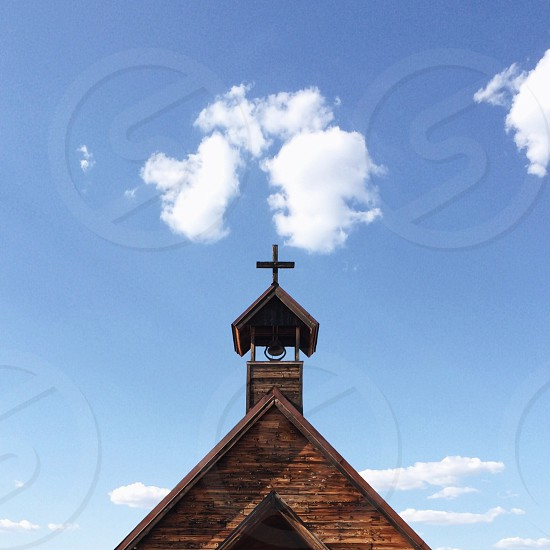cross pointed brown building photo