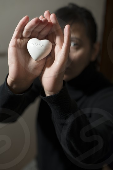 Woman hold in hands heart. Help concept and expectation photo