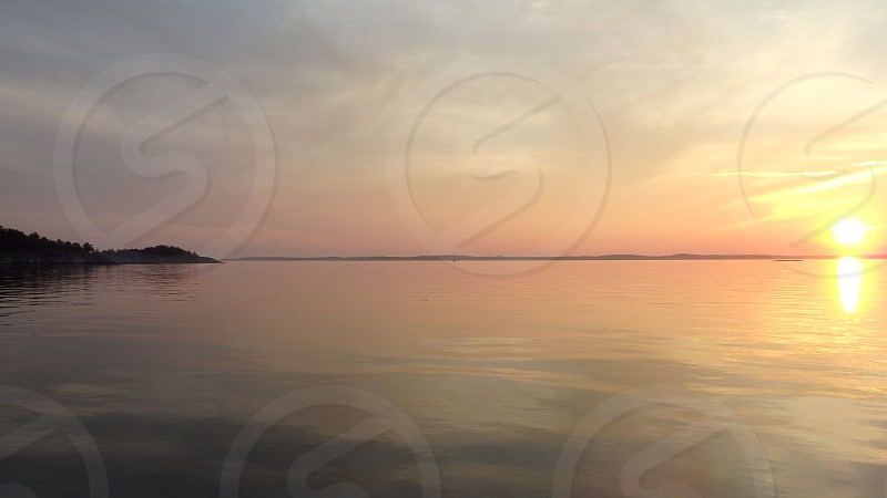 view of a large body of water during sunset photo