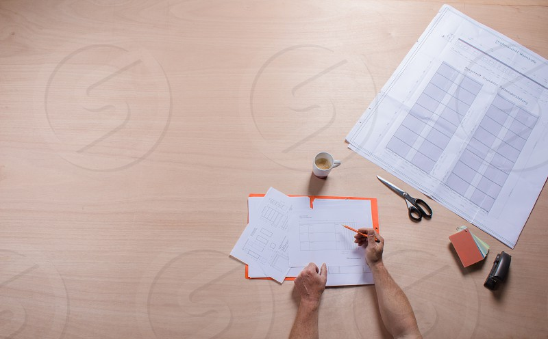 top view table top blueprint male hand making notes coffee photo