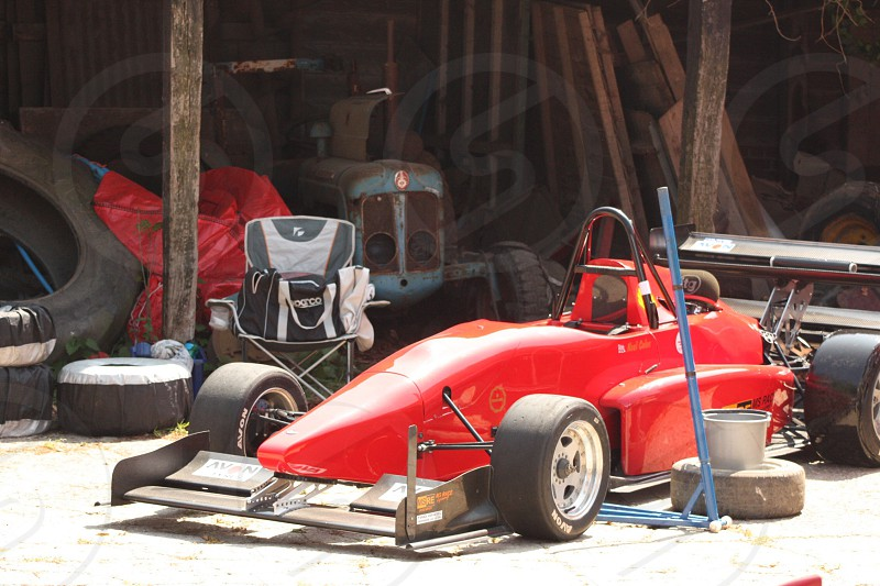 Old versus new tractor and race car race car tractor shed barn photo