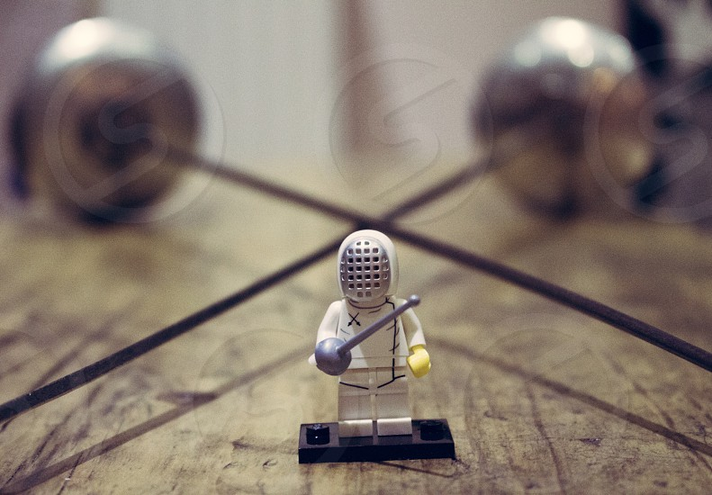 Lego fencer infront of two swords  photo