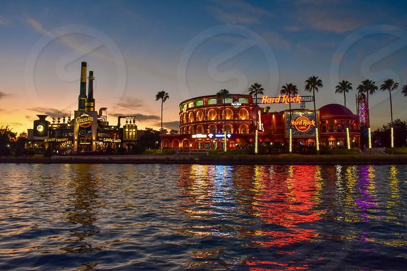 Orlando Florida. February 05 2019.  Chocolate Emporium Restaurant and Hard Rock Cafe on colorful sunset background at Universal Studios area. photo