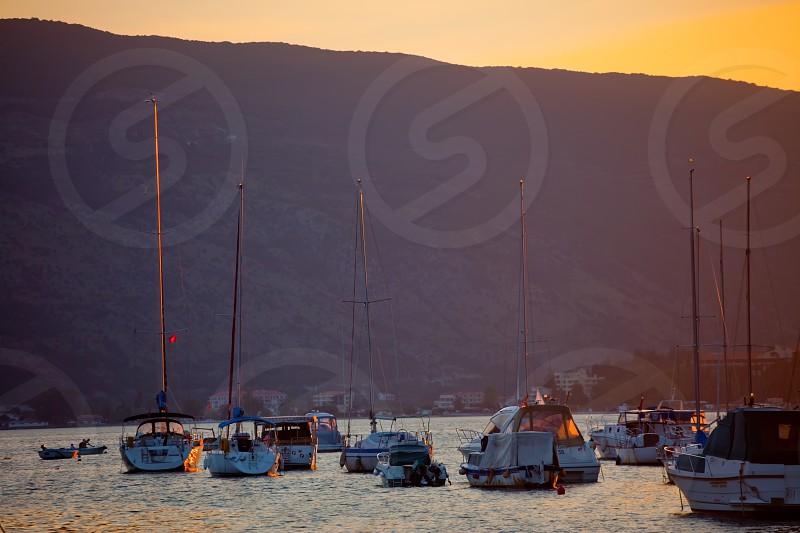 Boats in Boko Kotor bay at Sunset. Herceg Novi Montenegro photo