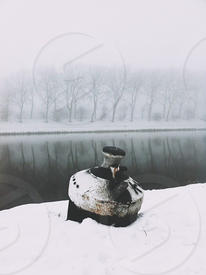 silver container on snow photo
