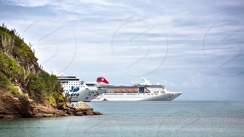 ship tourism cruise travel leisure sea water sky island tropical photo