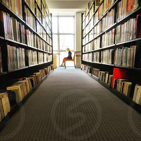 Library books child reading dyslexia San Francisco public library book shelves photo