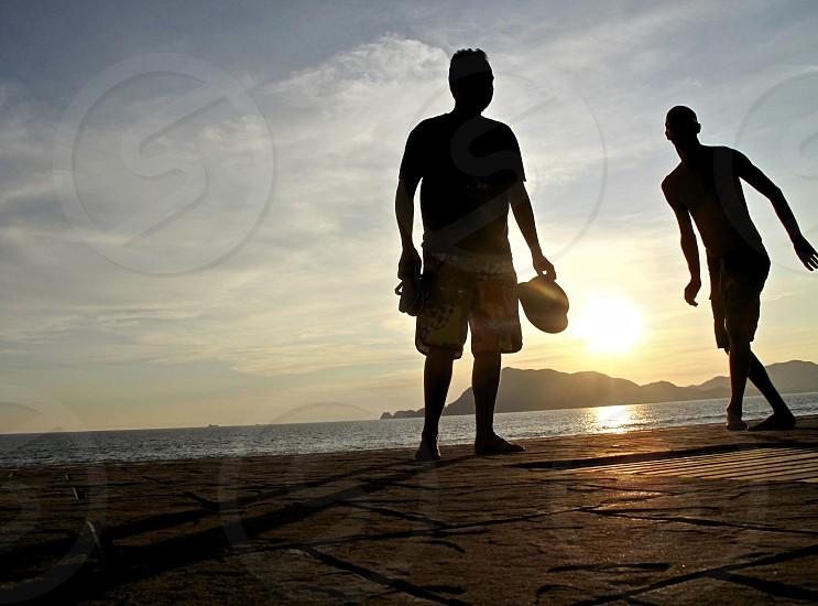 2 men silhouette photo