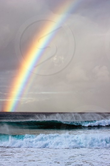 Surf surfing rainbow storm Oahu Hawaii  photo