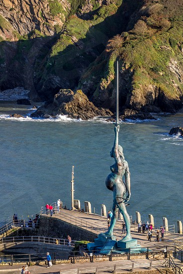 ILFRACOMBE DEVON/UK - OCTOBER 19 : View of Damien Hirst's Verity at Ilfracombe harbour in Devon on October 19 2013. Unidentified people photo