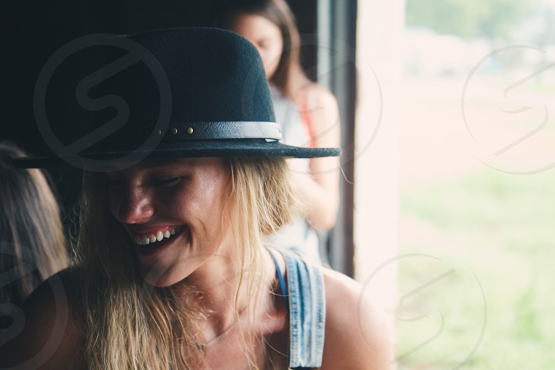woman with black hat laughing photo