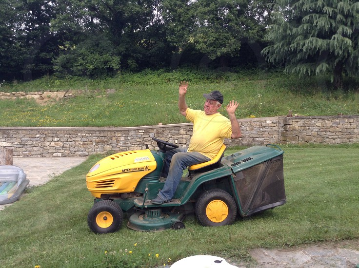 My dad having fun on his lawn mower photo