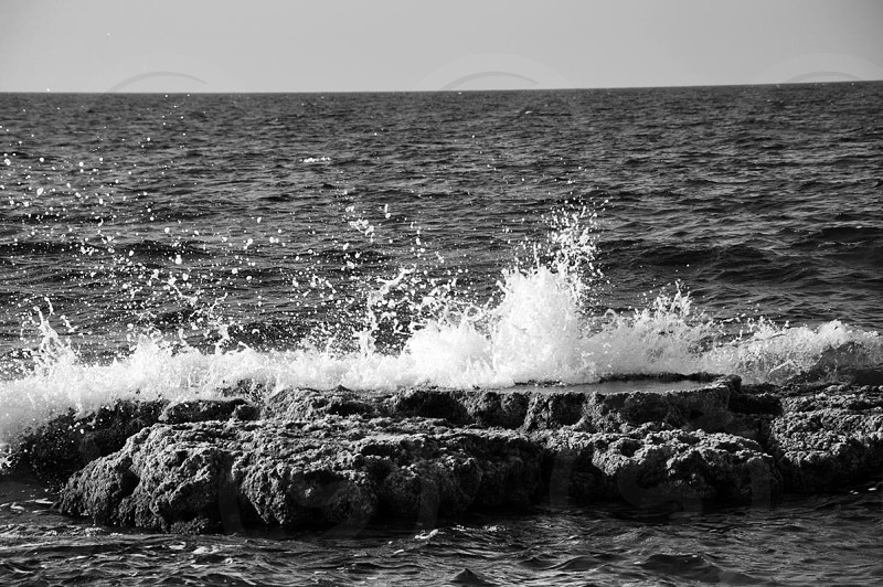black and white photograph of body of water photo