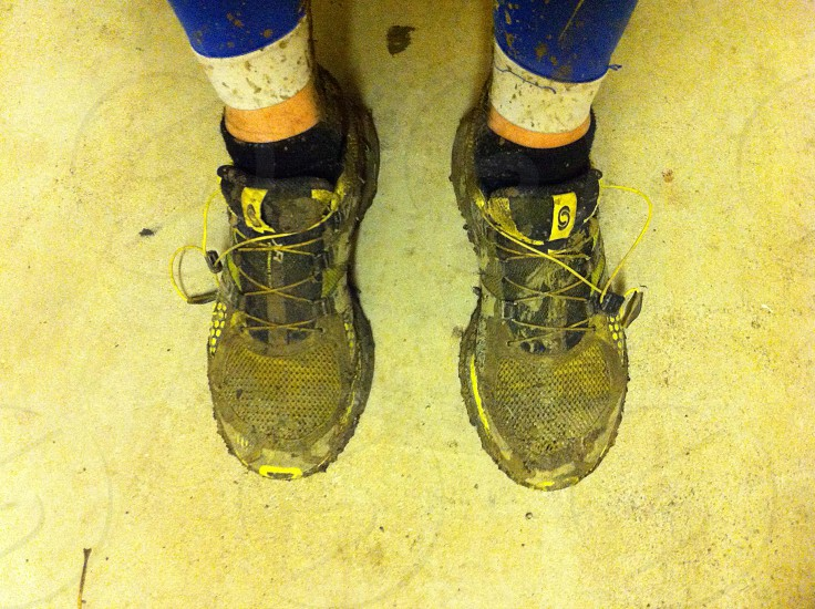 Muddy Salomon trainers after a trail run  photo