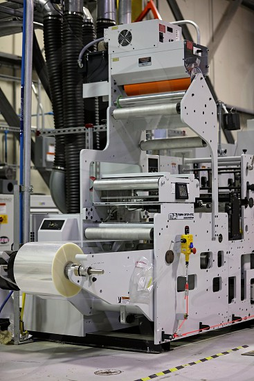 A printing press in an industrial location photo