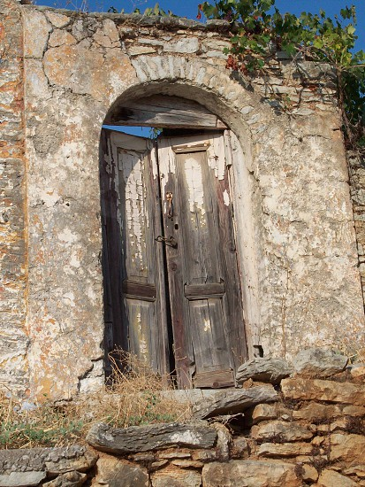 Greek Door - weathered - old - decaying -historical - eroded - architecture - opening photo