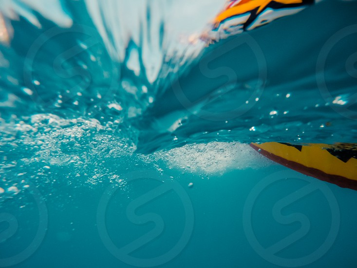 Underwater view of a moving inflatable ring that floating in the water. photo