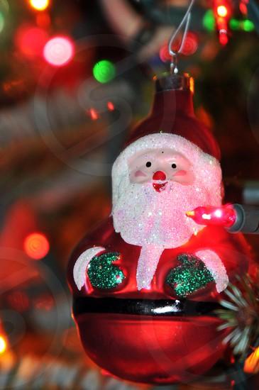 Santa holiday ornament on a Christmas tree photo