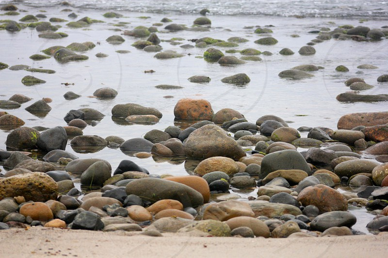 Rocks sand ocean wave water photo