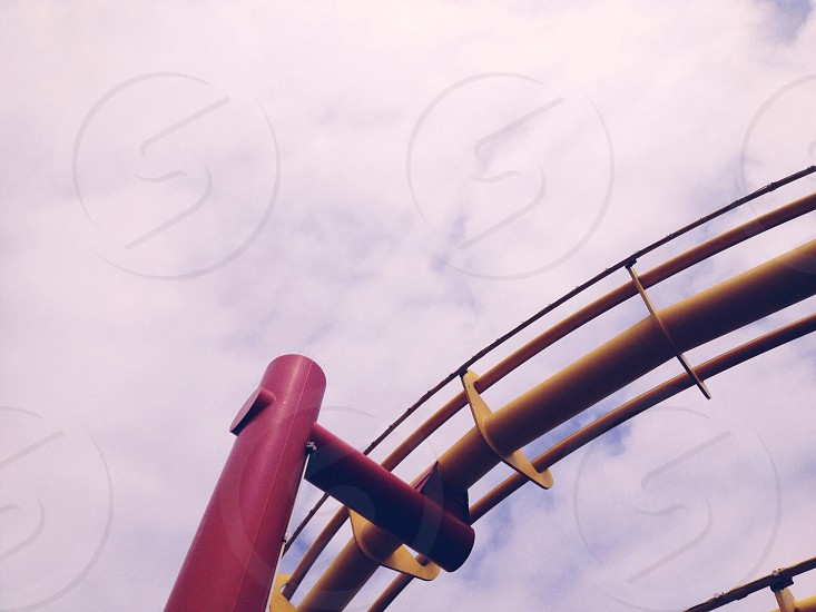 red and yellow theme park ride tracks photo