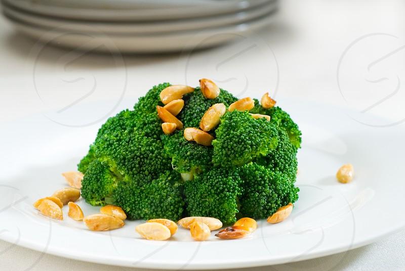 fresh and vivid sauteed broccoli and almonds very ealthy food photo
