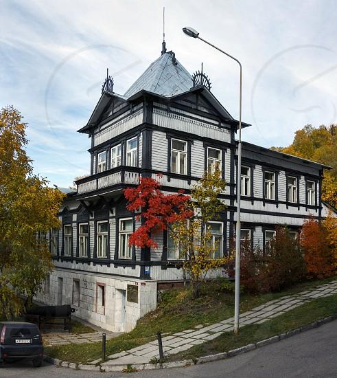 PETROPAVLOVSK-KAMCHATSKY KAMCHATKA RUSSIA - OCTOBER 1 2012: View of the old wooden building of the Kamchatka regional unified museum in the Petropavlovsk-Kamchatsky City. photo