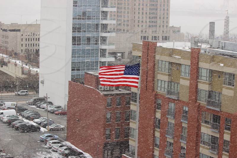 American Flag blowing in the snowy wind - Philadelphia PA photo