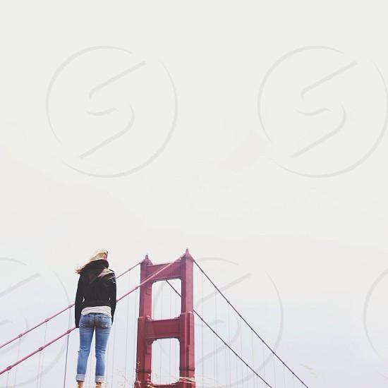 woman looking at golden gate bridge photo