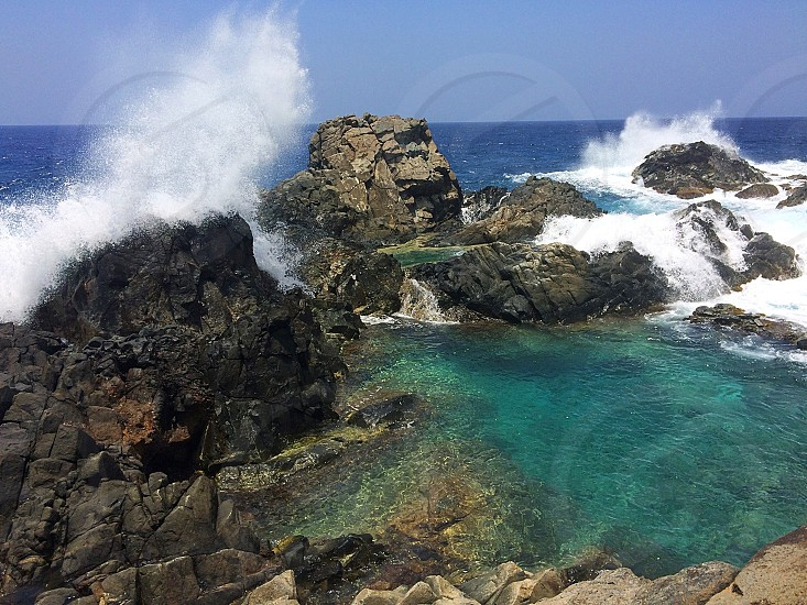Aruba natural pool nature sea ocean water rocks cliffs waves spray powerful beauty  photo