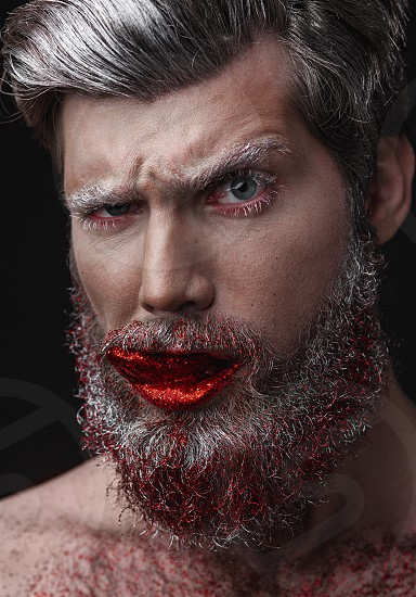 Creative Portrait of grey-haired fashionable man with red lips and tongue photo