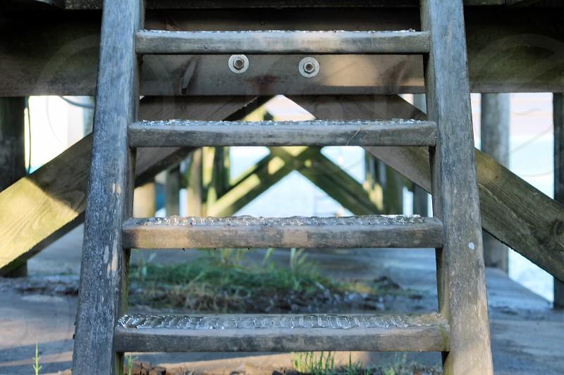 Under the boardwalkwoodstructurepierseabeachsandcoastal photo
