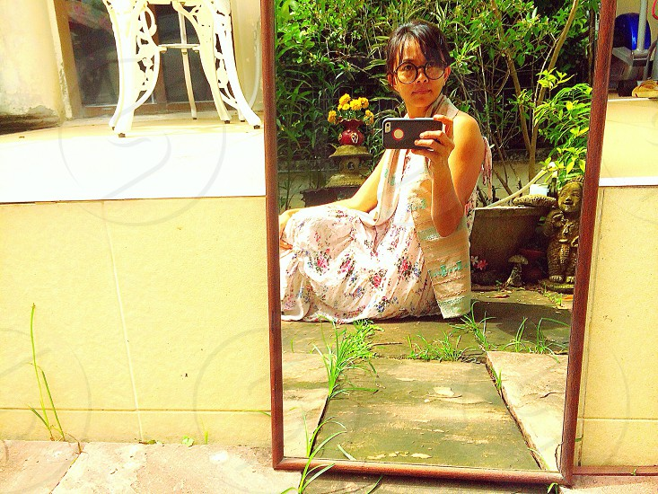 Portrait of Asian woman in mirror photo