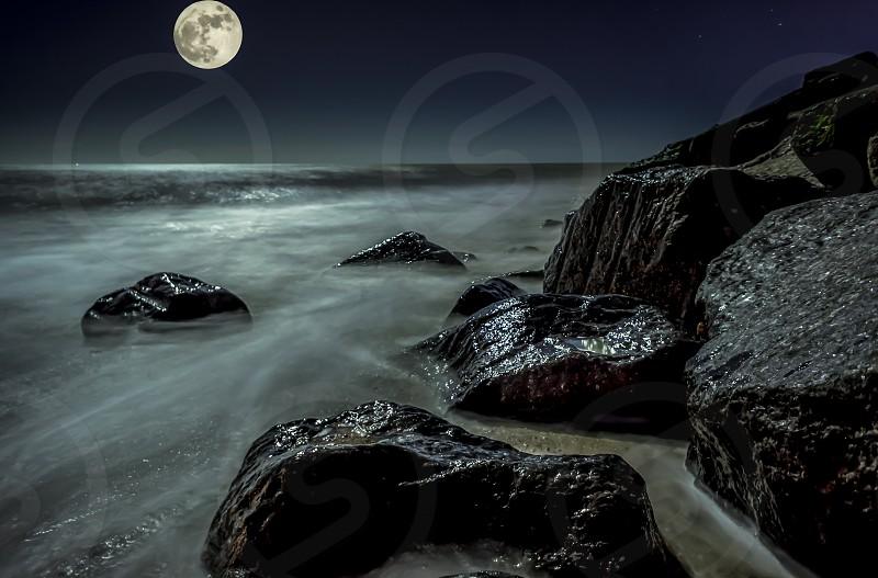 a lunar seascape taken on a long exposure photo