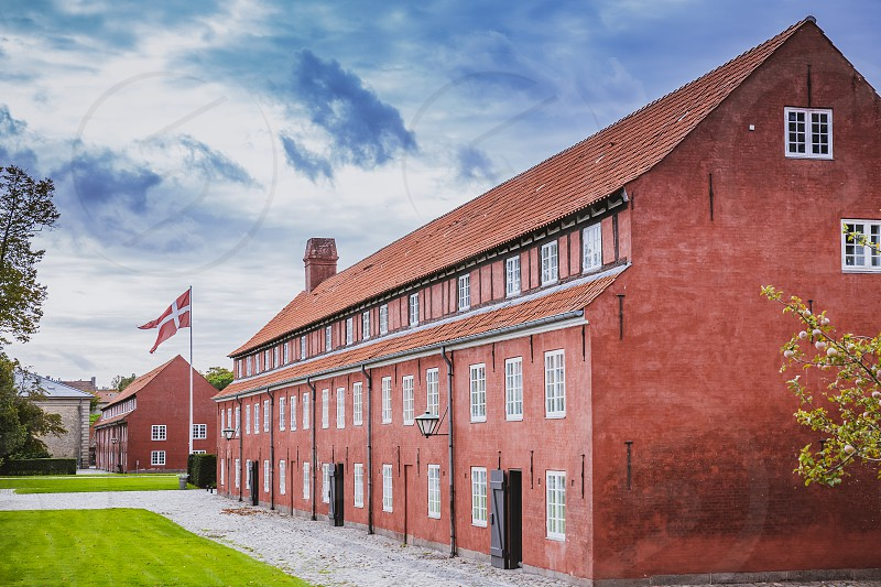 Red barrack in Kastellet a star shaped fortress in the central part of the city popular tourist place. Landmark in the old town photo