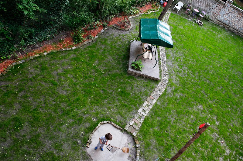 Green backyard in the centre of the city and kids enjoying their beautiful garden photo